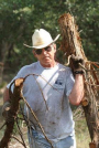 President Bush clears non-native cedar from the oaks at his ranch in Crawford, Texas, Aug. 9, 2002. (AP Photo/The White House, Eric Draper/File)