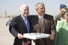 President George W. Bush joins Arizona Senator John McCain in a small celebration of McCain's 69th birthday Monday, Aug. 29, 2005, after the President's arrival at Luke Air Force Base near Phoenix. The President later spoke about Medicare to 400 guests at the Pueblo El Mirage RV Resort and Country Club in nearby El Mirage. White House photo by Paul Morse